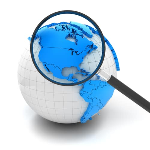 Globe with magnifying glass over north america and USA, 3d render